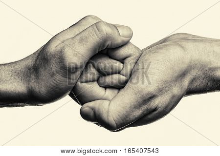 Male and female hand united in handshake. That could mean help guardianship protection love care etc. This Image isolated for easy transfer in your design.