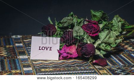Dried Red Roses, Words On A Paper Sticker