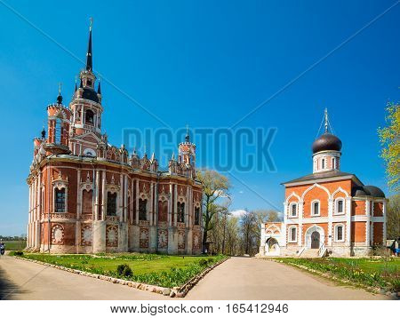 The New Nikolsky Cathedral in Mozhaysk Kremlin Russia. A larger blood-red cathedral in the Gothic Revival style.
