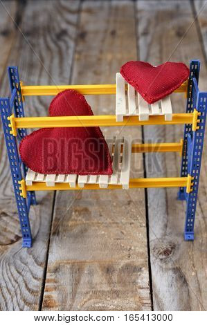 Red hearts handmade on pallets on a shelf