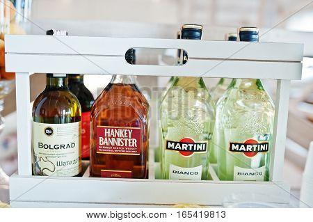 Hai, Ukraine - January 5, 2017: Bottles On Bar: Martini, Hankey Bannister, Bolgrad Vine.