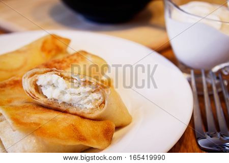 Pancakes stuffed with cottage cheese for breakfast