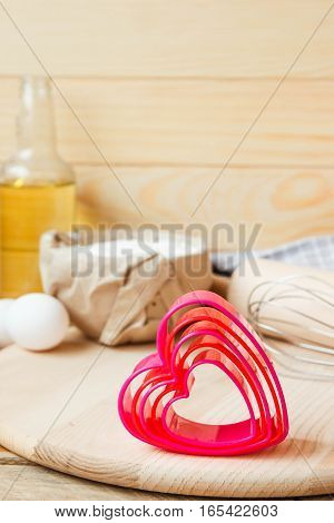 Baking heart shaped cookies for St. Valentine's day.