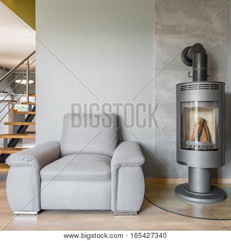 Comfortable Armchair And Fireplace