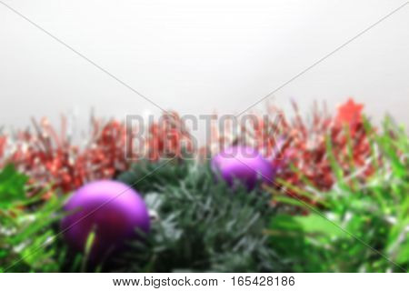 blurred Christmas background with ball and bell. blurred Abstract christmas background