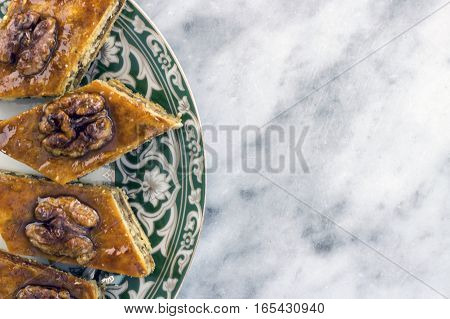 Honey baklava on the saucer with oriental design