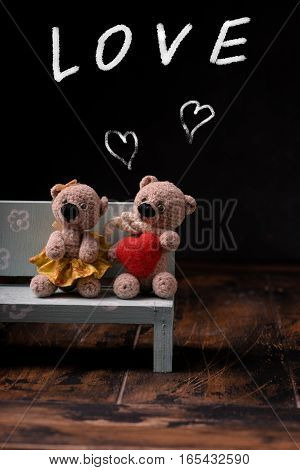 Valentines Day. Love heart. Couple Teddy Bears. Handmade toys. An offer of marriage. Vintage retro romantic style. Family, wedding and friendship. Chalkboard with chalk.