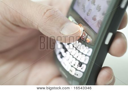 hand holding pda cell phone, concept of receiving email