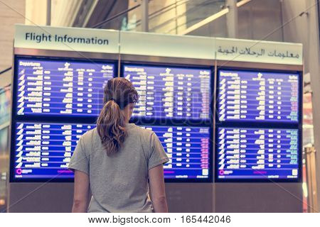 Young female traveler deciding where to go. Millenial traveling abroad.