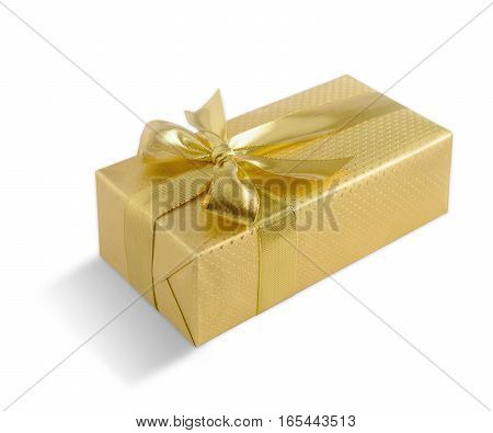 Gold gift box with golden bow isolated on white background. Clipping path included.