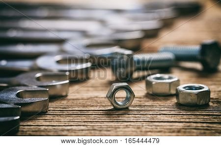 Set Of Wrenches Bolts And Nuts On Wooden Background