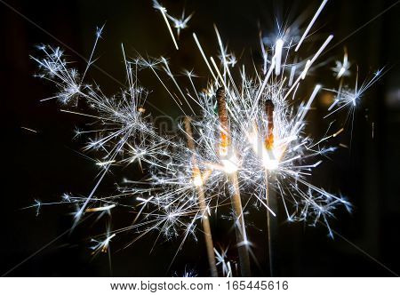 bengal fires, beautiful sparks on a black background