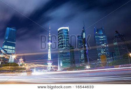 Traffic through downtown  the lujiazui financial centre in shanghai china.
