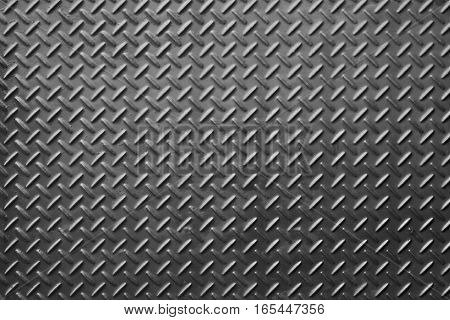 Metal diamond plate or old checkered steel plate with rustproof coating well. background. texture.