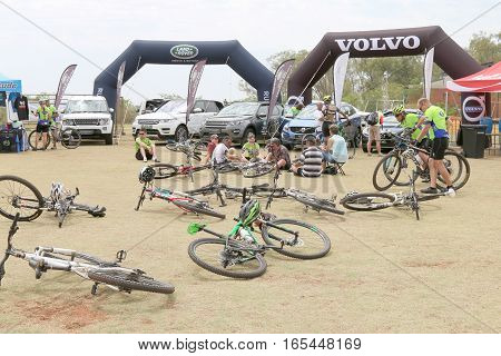 Abandoned Bicycles In Front Of Luxury 4X4 Motor Car Display At Bike Race