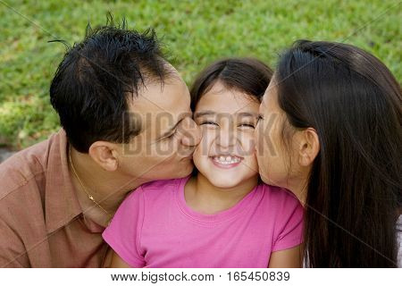 Portrait of Asian parents and their children.