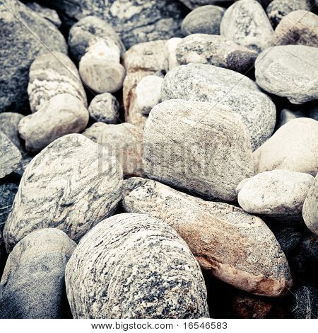 Stones Stacked Up on the sand beach outdoor.