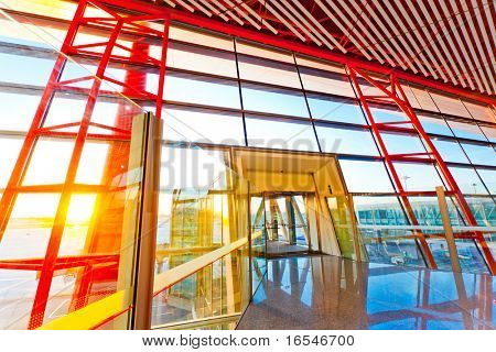 apron of beijing airport in sunset,view of the glass window.