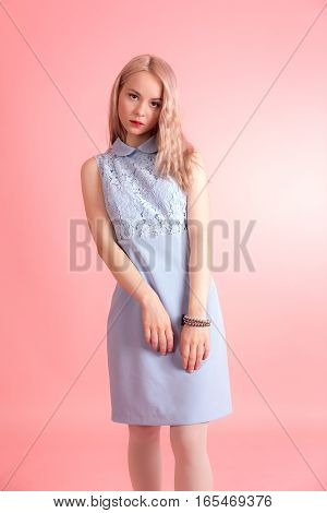 Slim sensual girl on a pink background