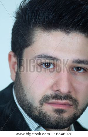 Vertical Shot Of Serious Man With Beard