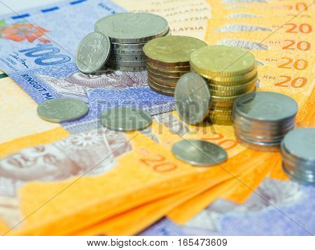 Close Up of Malaysia currency RM 20 and 100 ringgit Banknotes and coins, Finance Concept Selective Focus