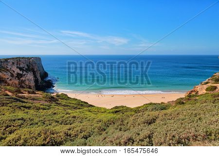 View of the beach and the mountains on the coast of the Atlantic Ocean on a sunny day. Portugal.