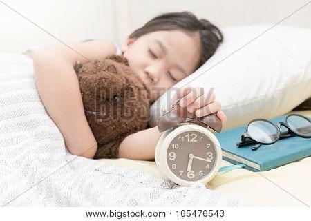 Cute Little Hand Girl Reaching To Turn Off Alarm Clock