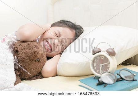Annoyed Girl Being Awakened By An Alarm Clock