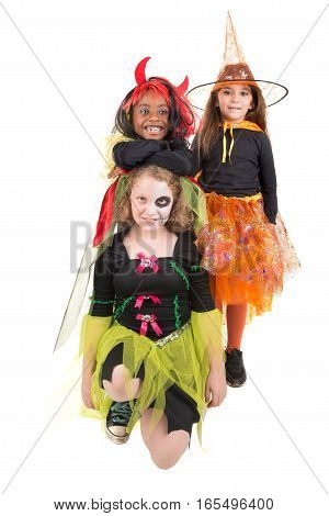 Girls with face-paint and Halloween costumes over a white background