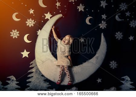the girl sleeping on the moon in an embrace with a pillow