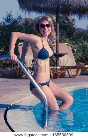 Blond In Bikini Going To Swim
