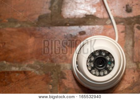 CCTV security camera on the wall for private property protection