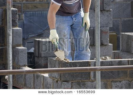 Bricklayer building a wall on a construction site