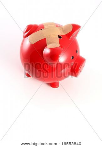 Piggy bank with slot covered leaving no chance of saving money