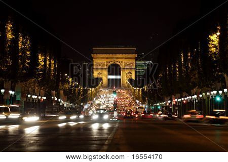 Arc de Triomphe and Champs-Elysees Avenue in Paris at dusk