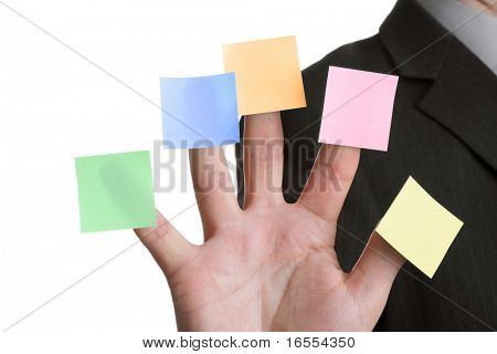 Businessman holds up five blank multi coloured stickies, one on each finger ready for text messages