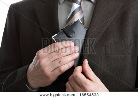 Businessman taking his wallet out of his pocket to pay