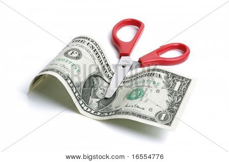 Red scissors about to cut a US one dollar bill, concept for budget cuts or recession