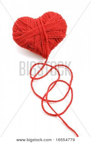 Red heart shape symbol made from wool isolated on white background