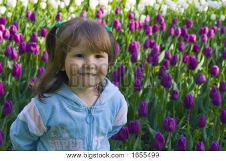 Happy Girl In Tulips