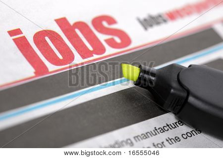 Job listing pages of a newspaper with highlighter pen