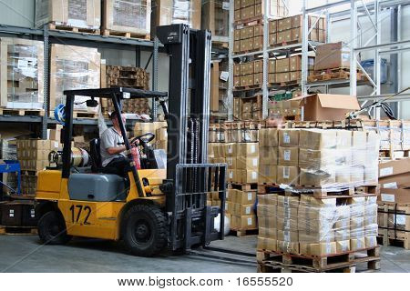 Pallet truck working at the warehouse