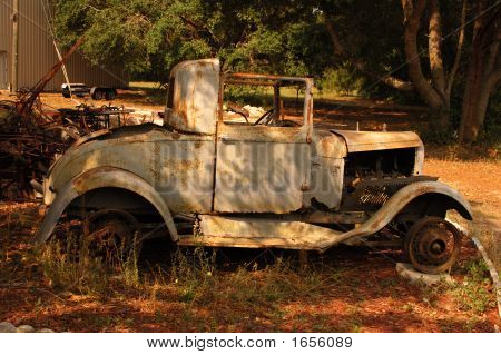 OLD CAR HAS SEEN BETTER DAYS IN
