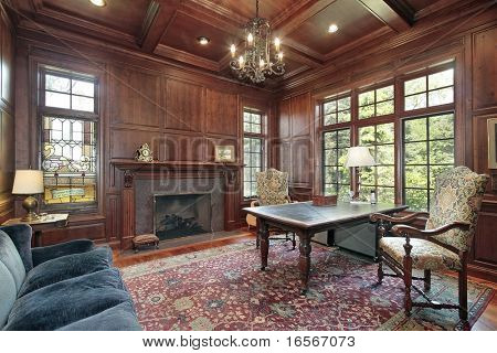 Office with wood paneling and fireplace