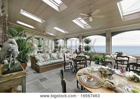 Porch in mansion with lake view
