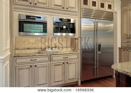 Closeup of luxury kitchen with oak wood cabinetry