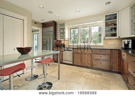 Kitchen in suburban home with rectangular glass table