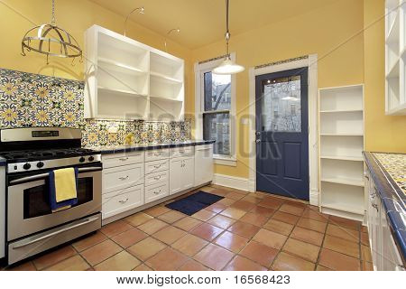 Kitchen in suburban home with terra cotta floor tile