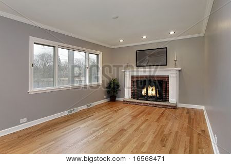 Family room in remodeled home with brick fireplace Picture - Royalty