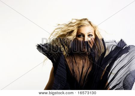 Under a veil of secrecy. Beautiful woman. Fashion art photo